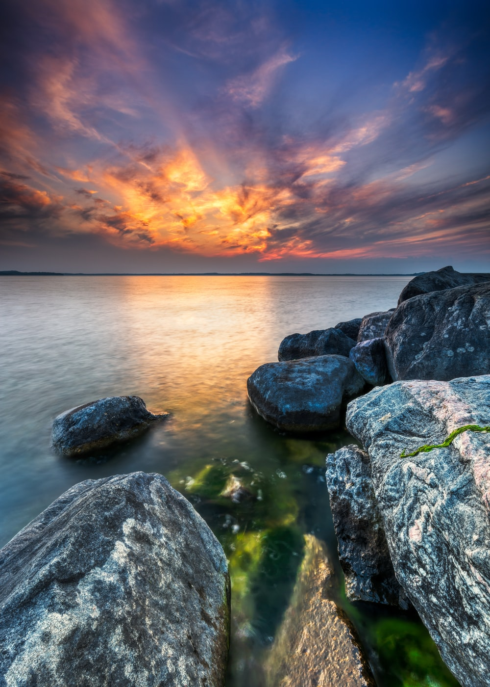 rock formations beside body of water at golden hour