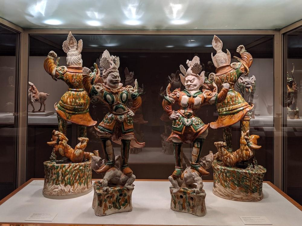 four god figurines