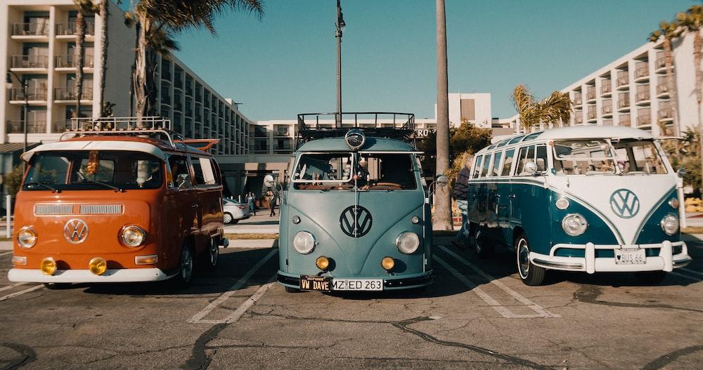 three assorted-color Volkswagen Type 2 T1