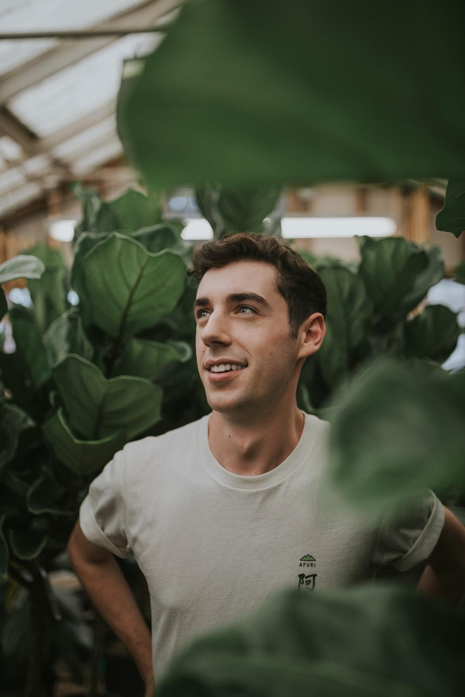 smiling man wearing white shirt