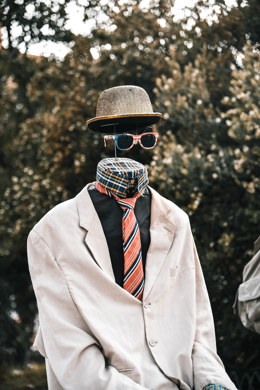necktie, hat, and sunglasses