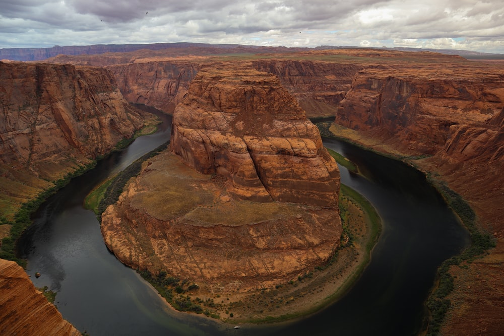 aerial photography of river and mountain range