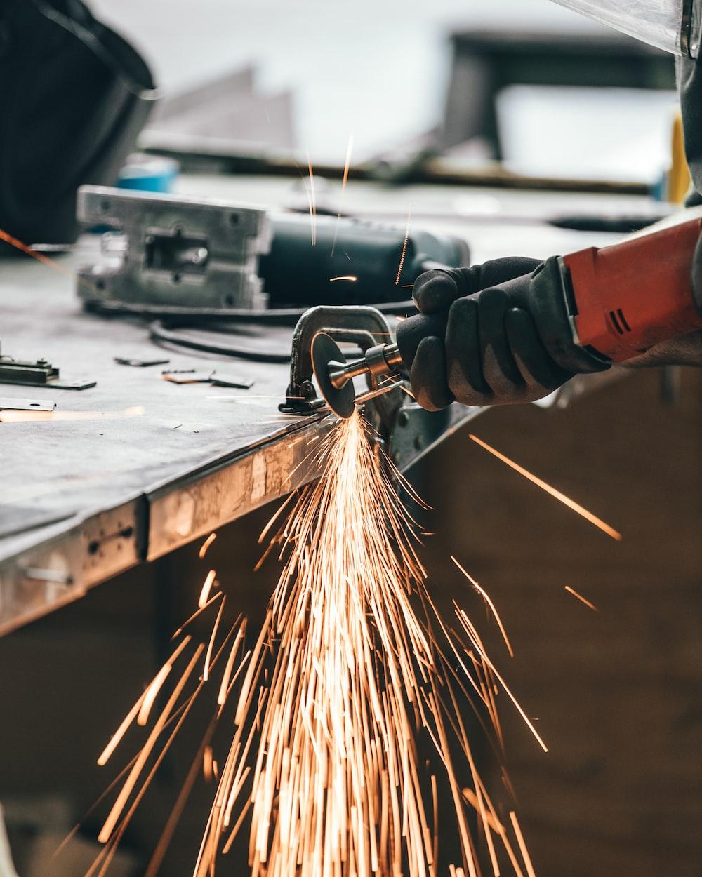 man cutting metal