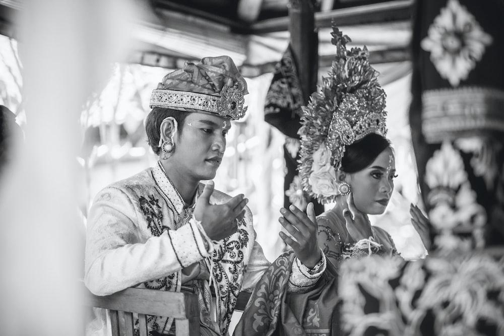 grayscale photography of groom and bridge