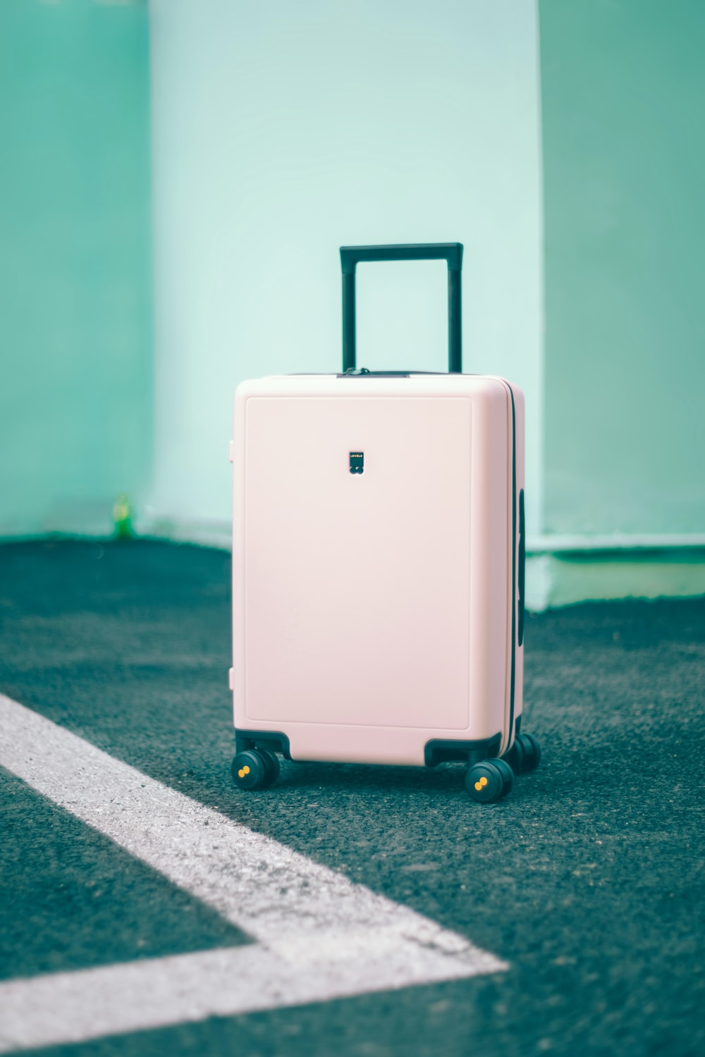 white and black luggage