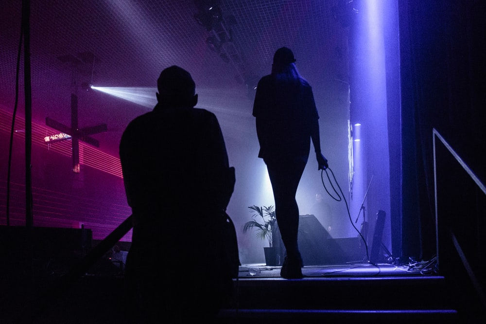 silhouette of person standing on stage