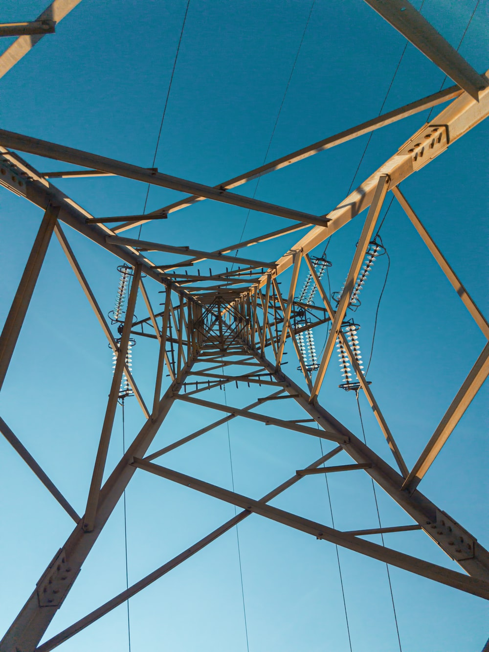 Power lines, cable, electric transmission tower and utility pole