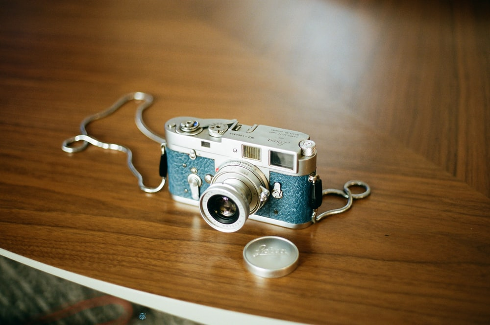 blue and gray camera close-up photography