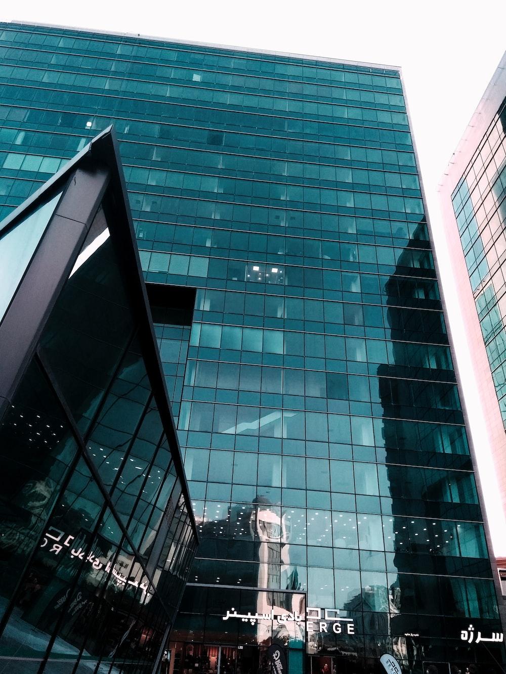 green glass facade high rise building