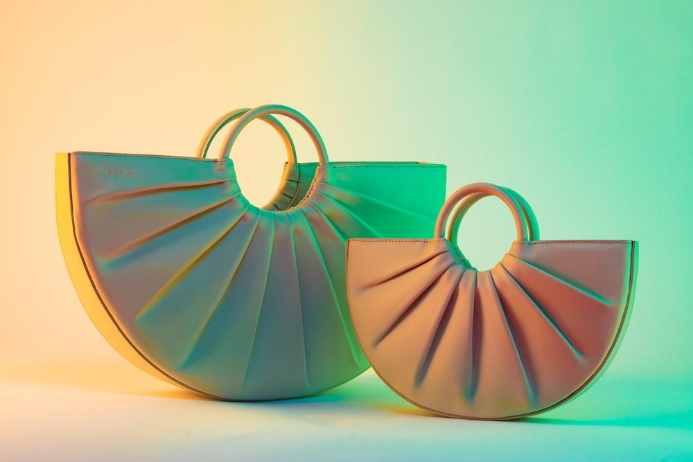 two gray and brown handbags