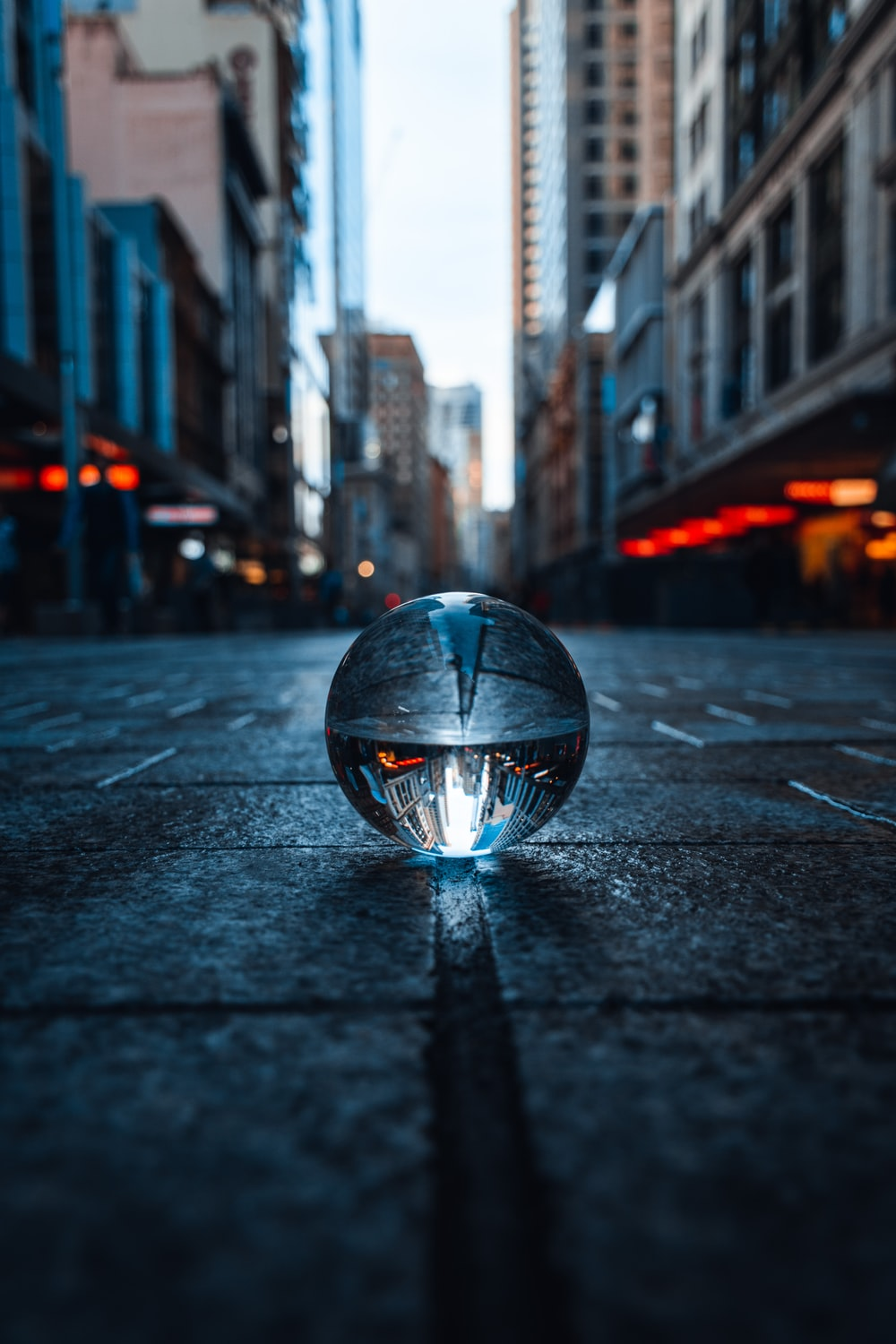 clear glass ball on road during nightime