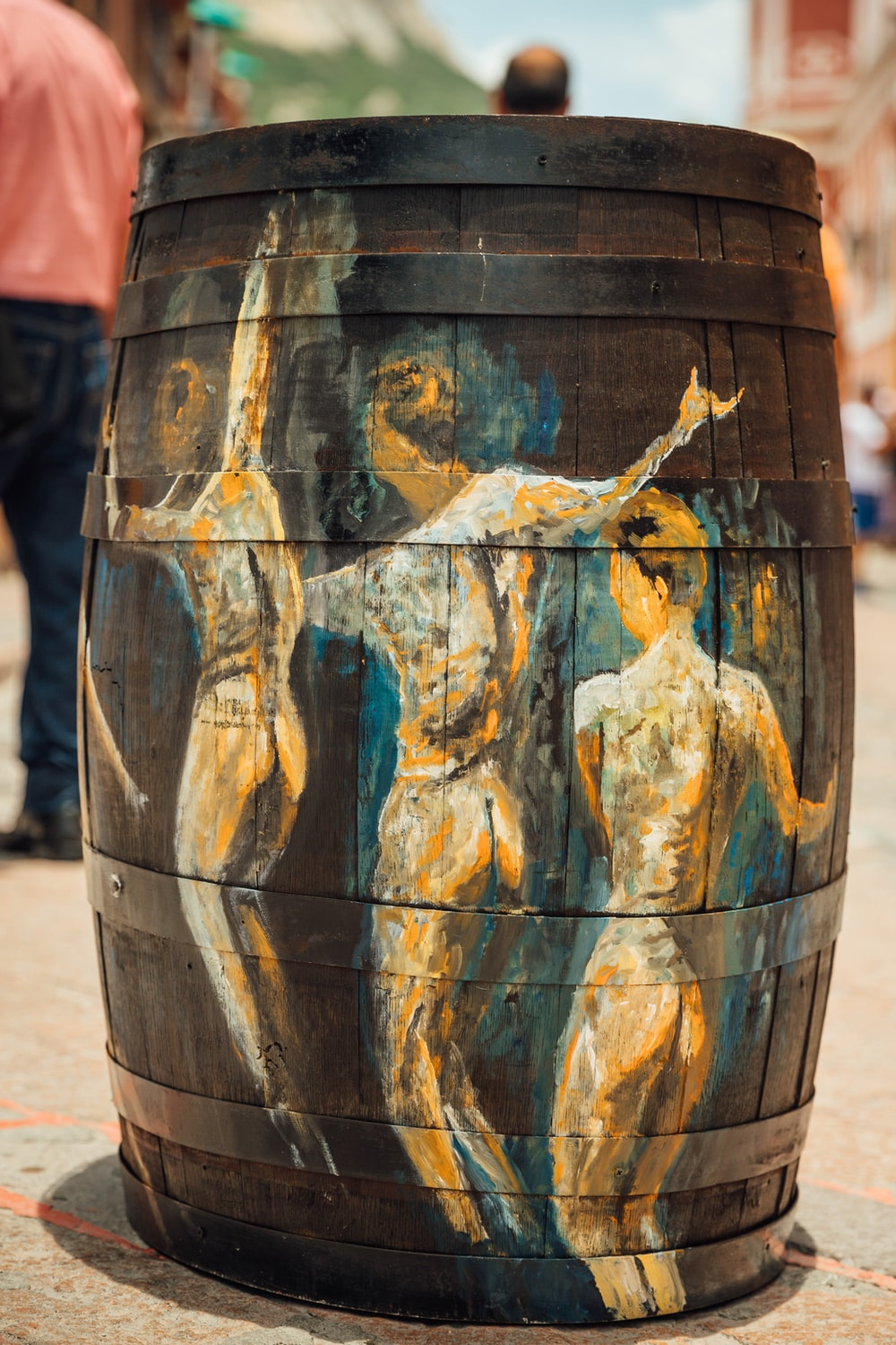 brown wooden barrel with painting