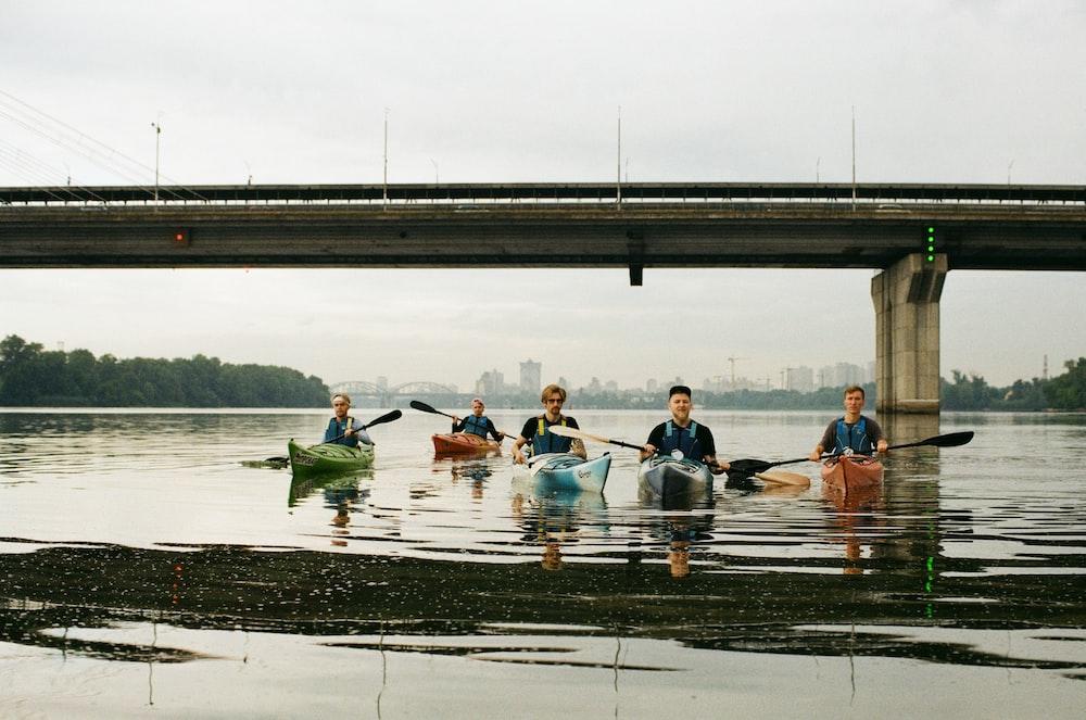 men on kayaks