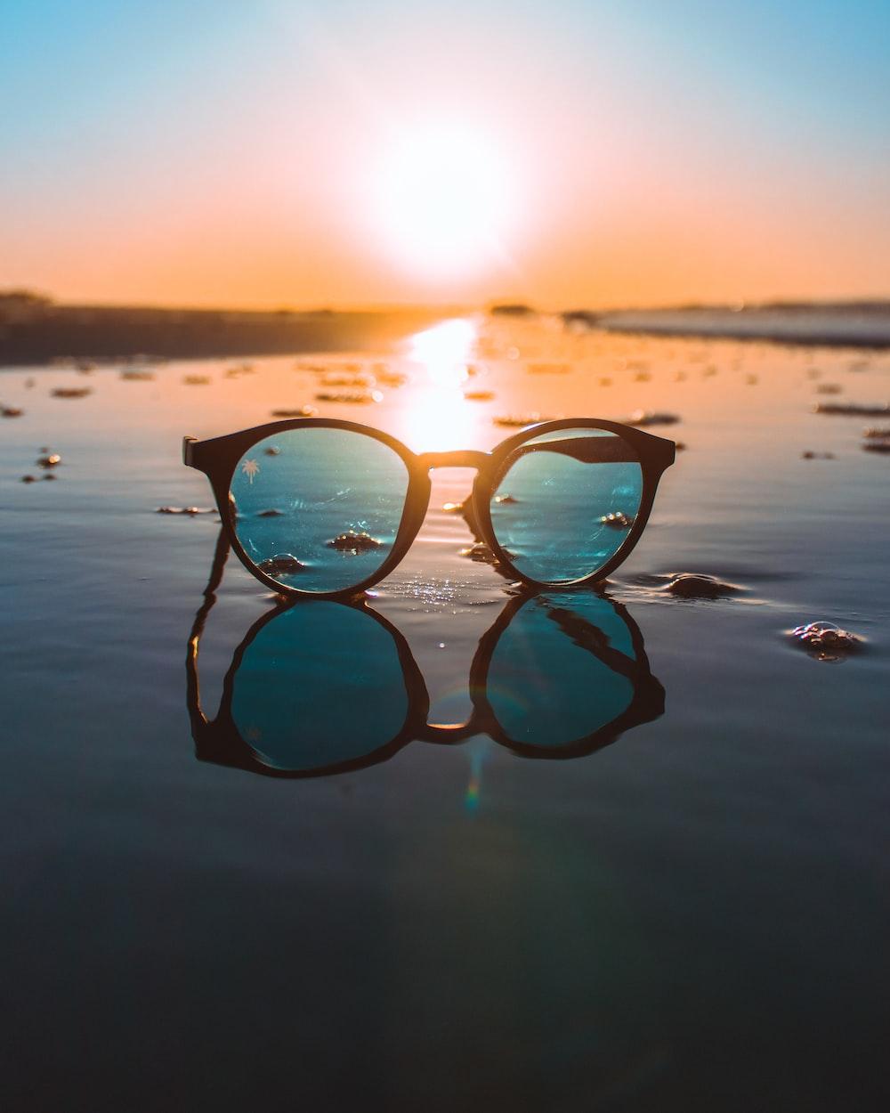 black framed teal lens sunglasses during daytime