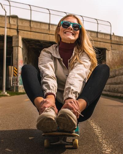 Girl on a skateboard.
