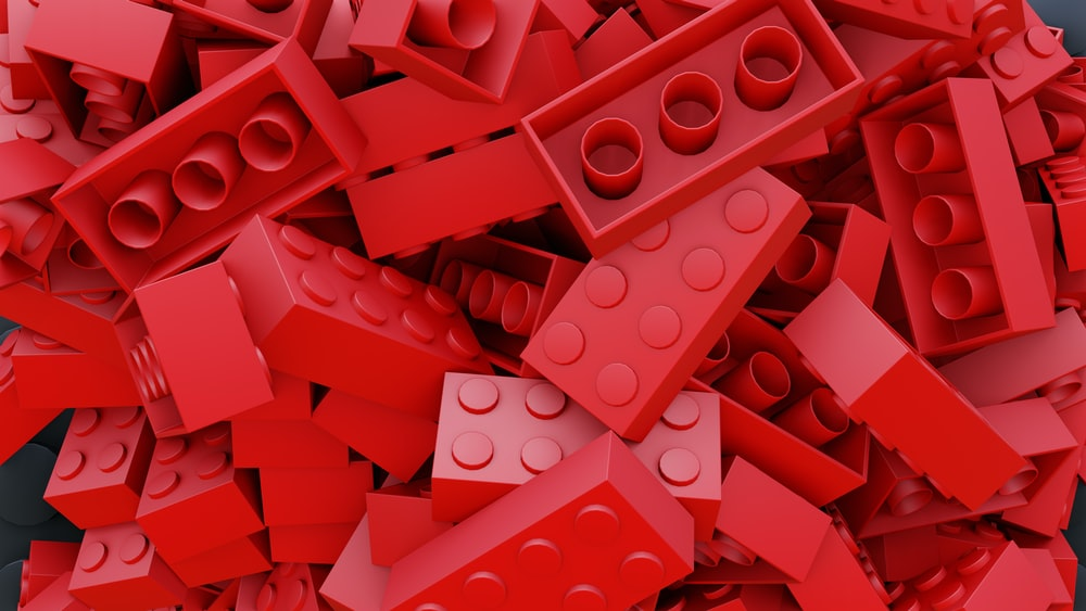 pile of red toy blocks