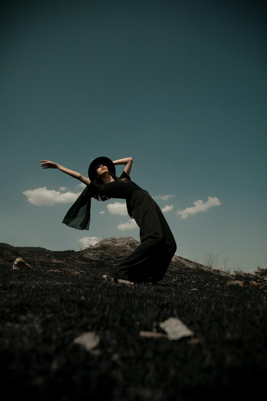 woman in black dress bending