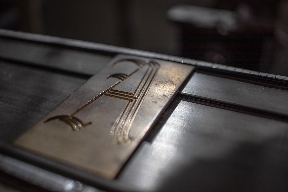 selective focus photography of letter A ornament