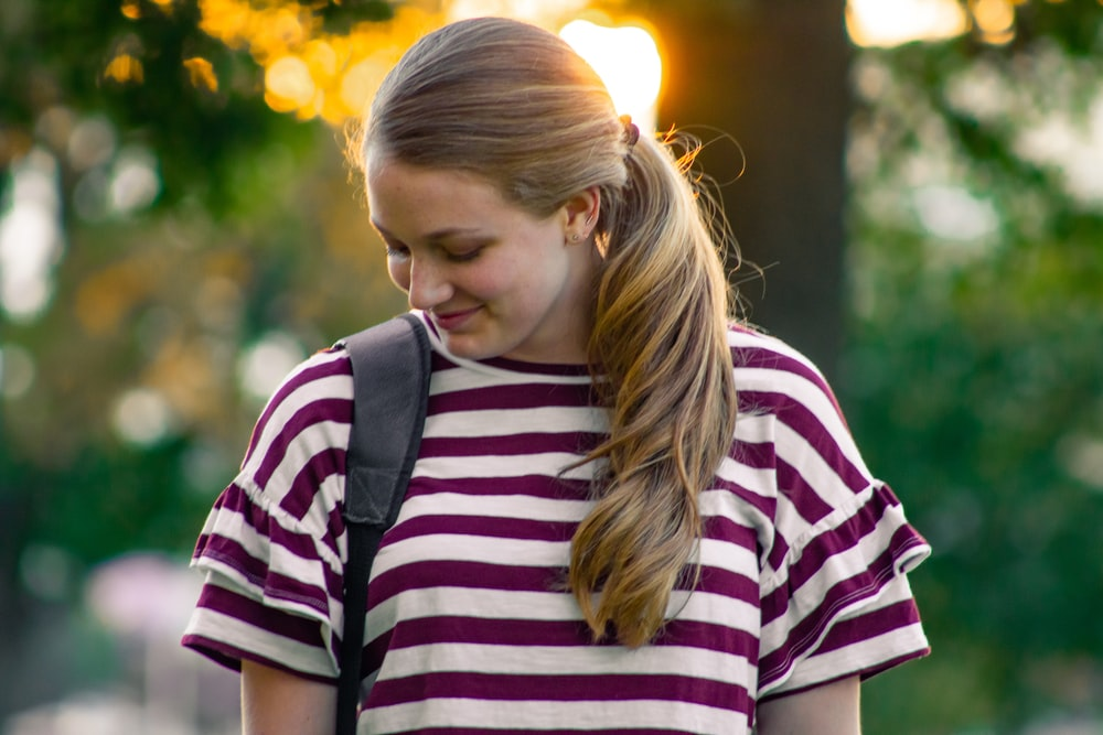 women's purple and white striped crew-neck shirt close-up photography