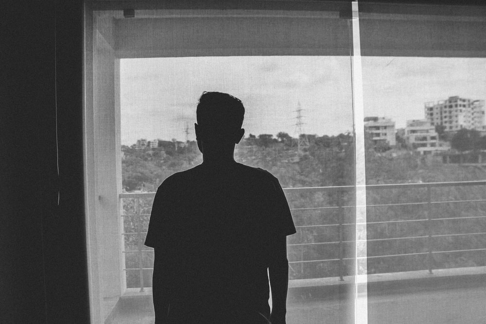 silhouette of man standing inside room