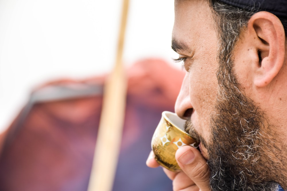 closeup photo of man drinking