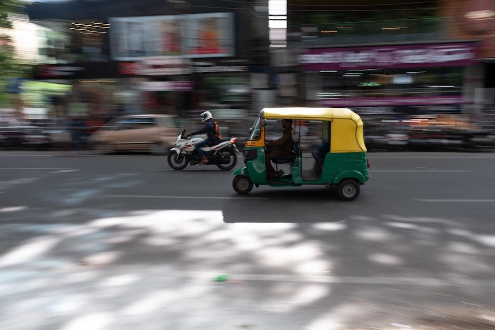 yellow auto-rickshaw