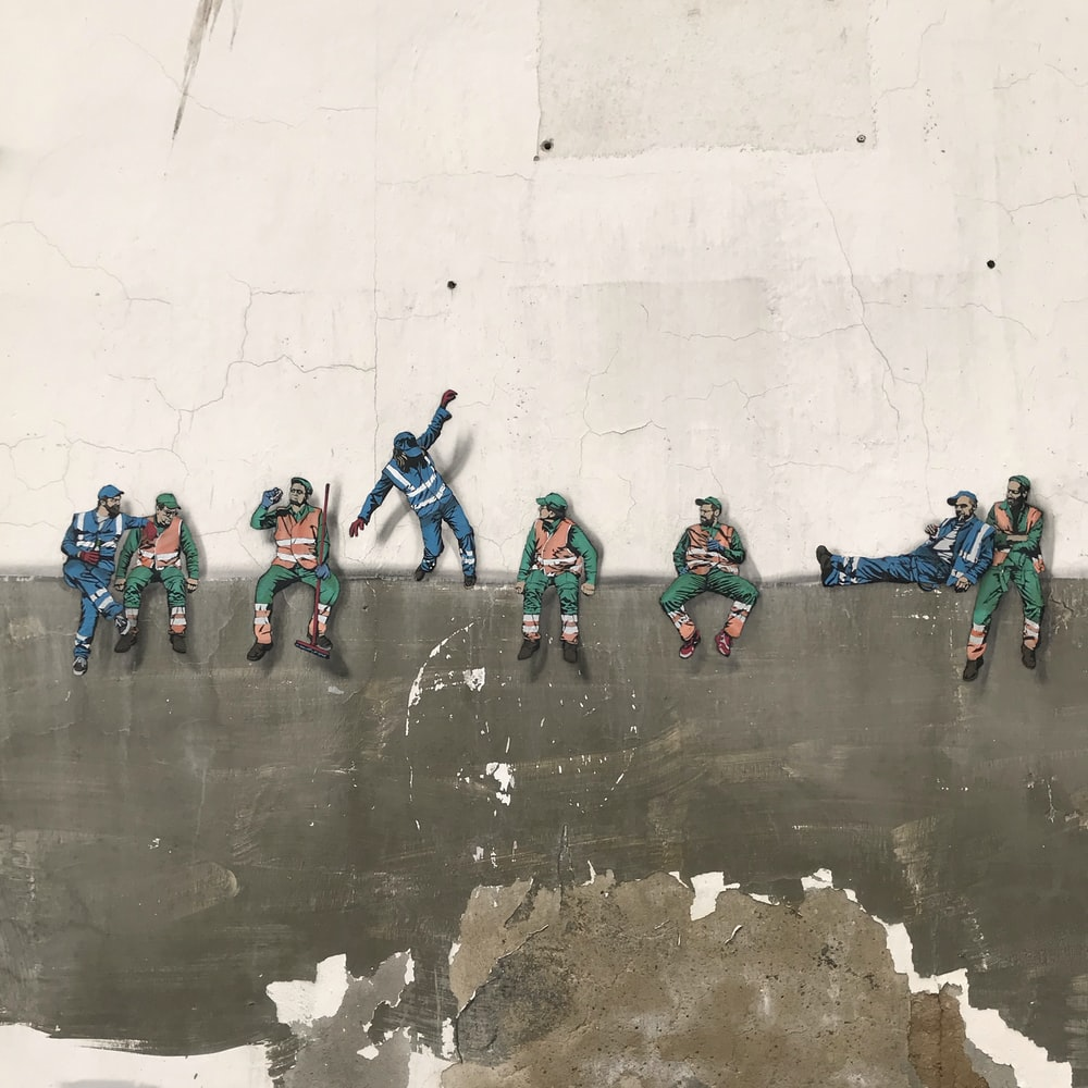 workers on wall painting