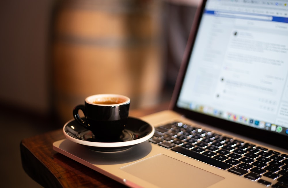 cup of coffee on laptop