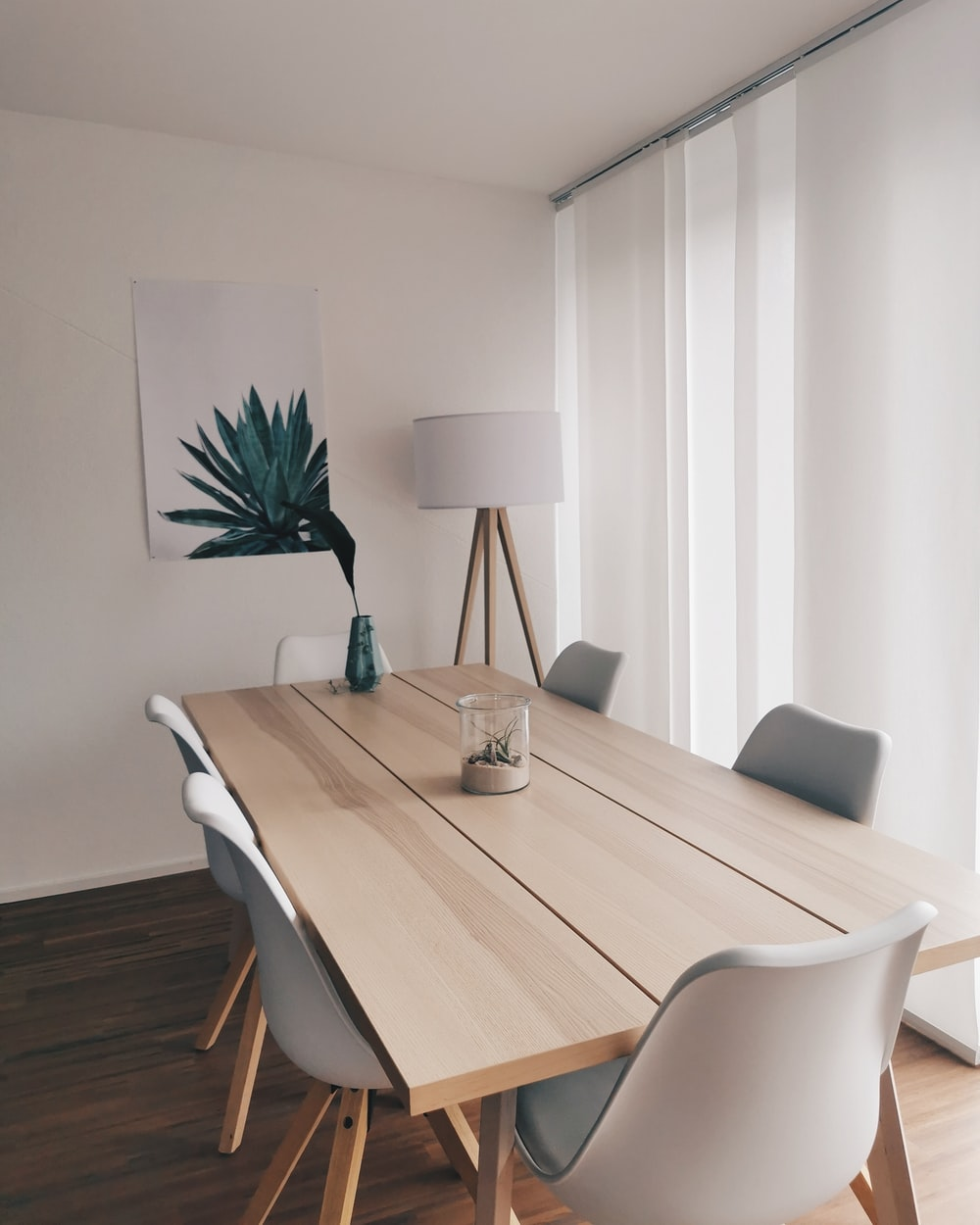 agave painting and brown wooden 7-piece table