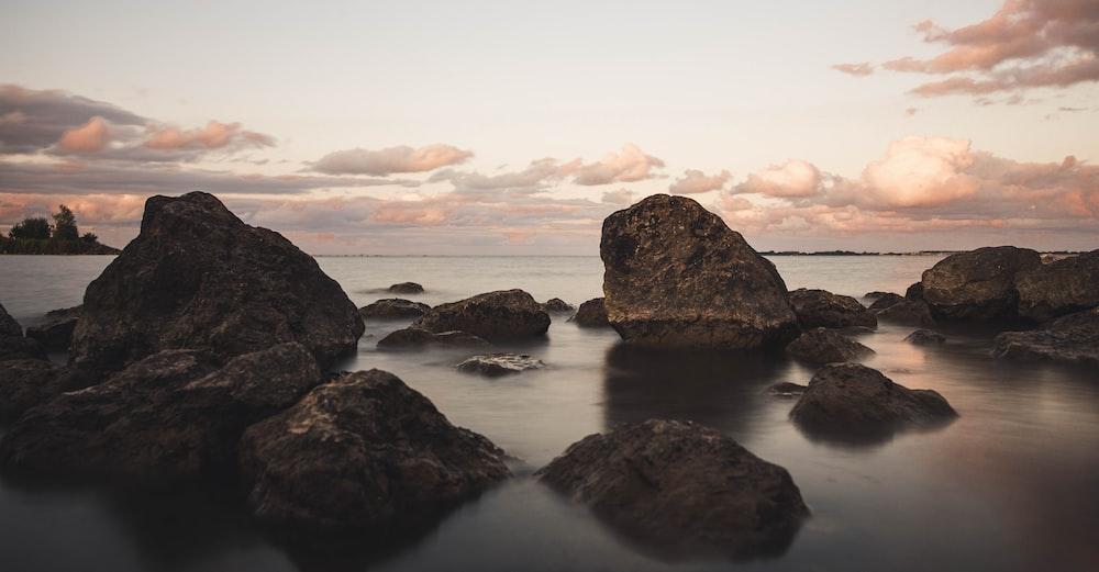 brown rock on ocean
