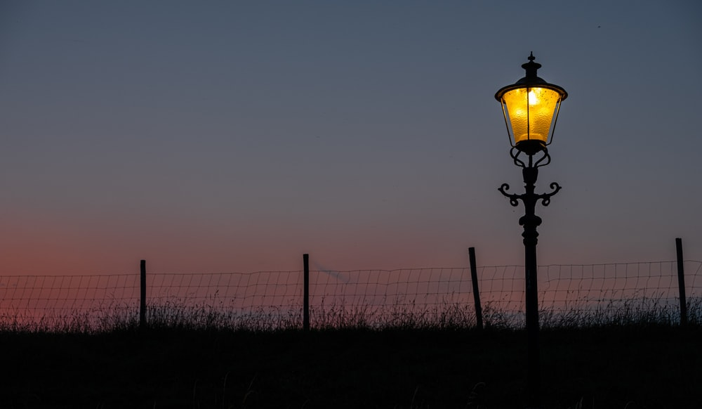turned-on lamppost