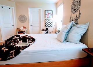 white mattress and black bedspread