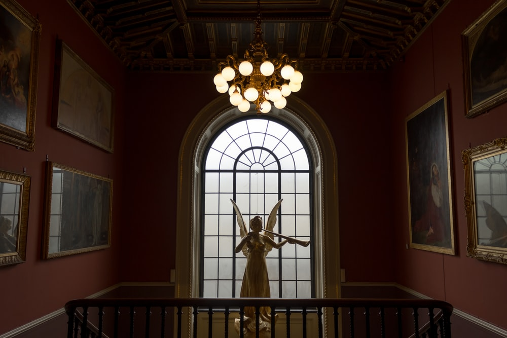 angel statue in front of window