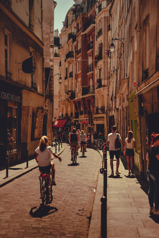 people walking on streets beside buildings