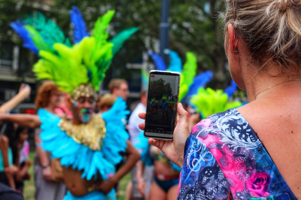 woman taking photo of festival