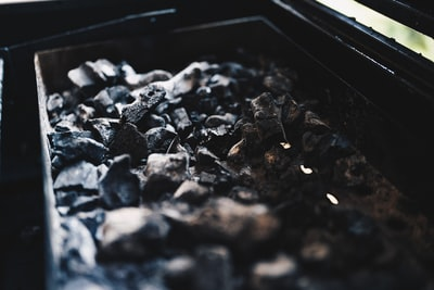 selective focus photography of black charcoal coal teams background