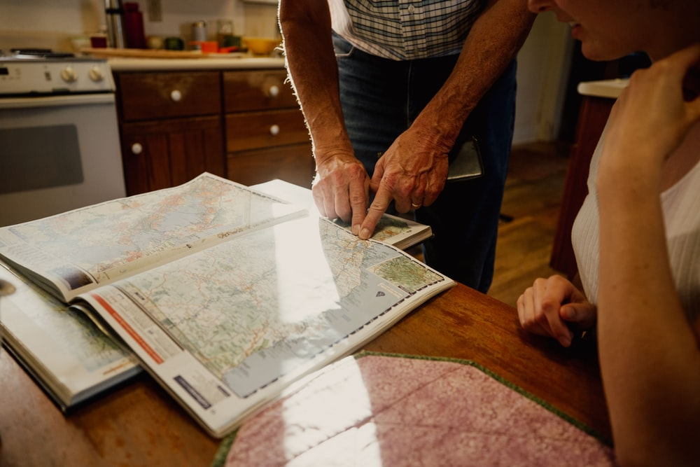 man pointing on country map