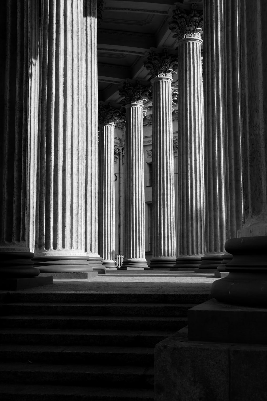 graytscale photography of concrete pillars
