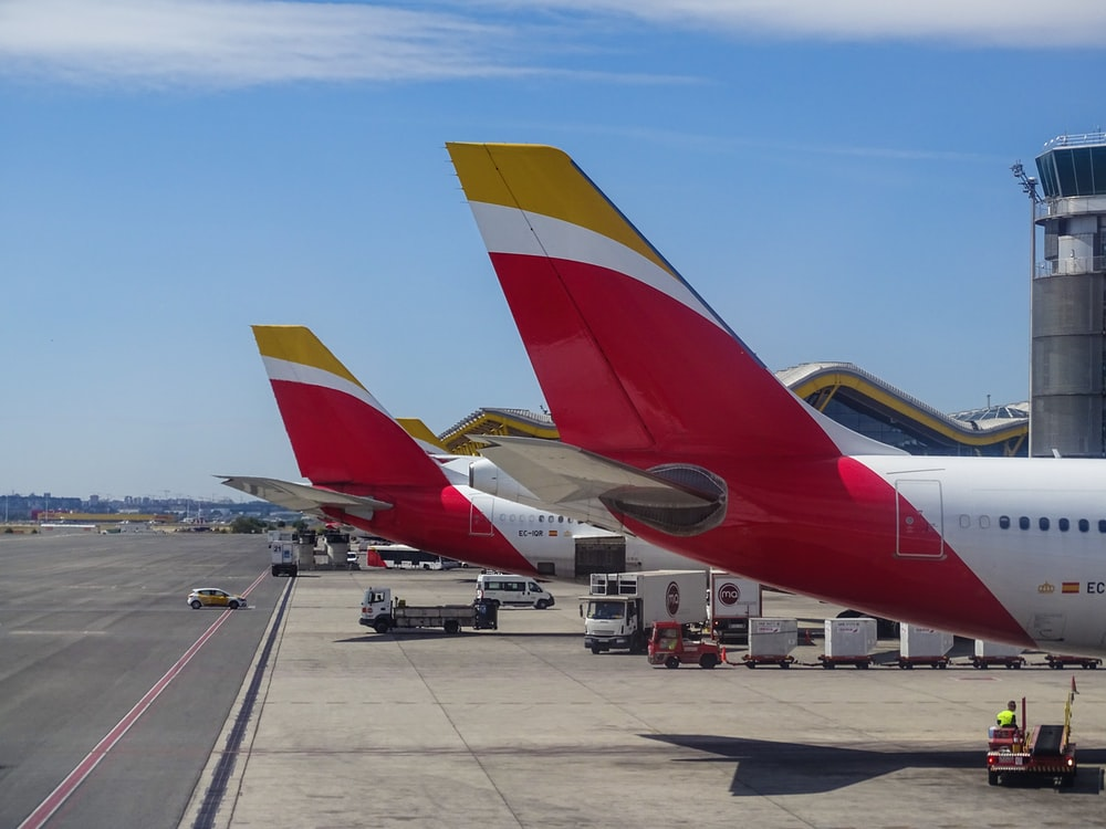 two Austrian Airlines at the airport during daytime