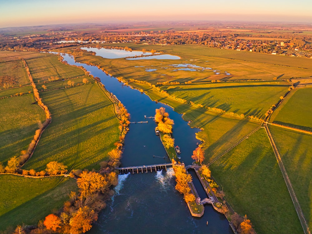 aerial photography of river and open field during daytime
