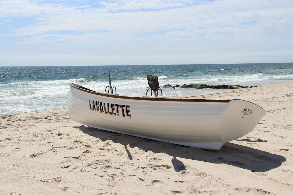 white boat near sea