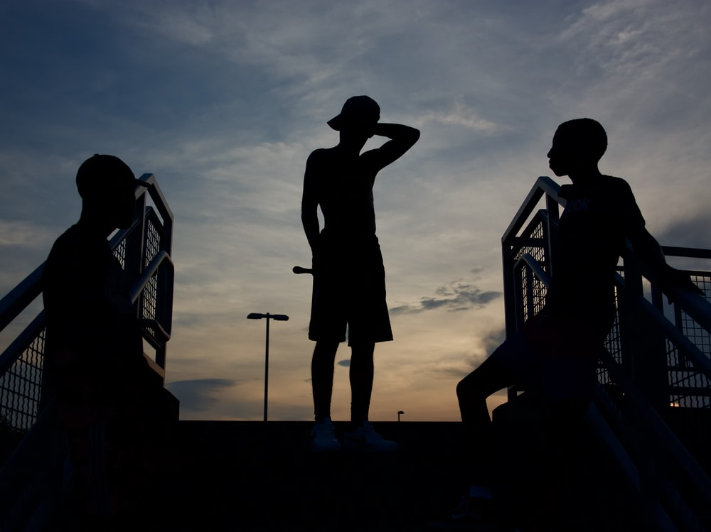 silhouette of standing three person