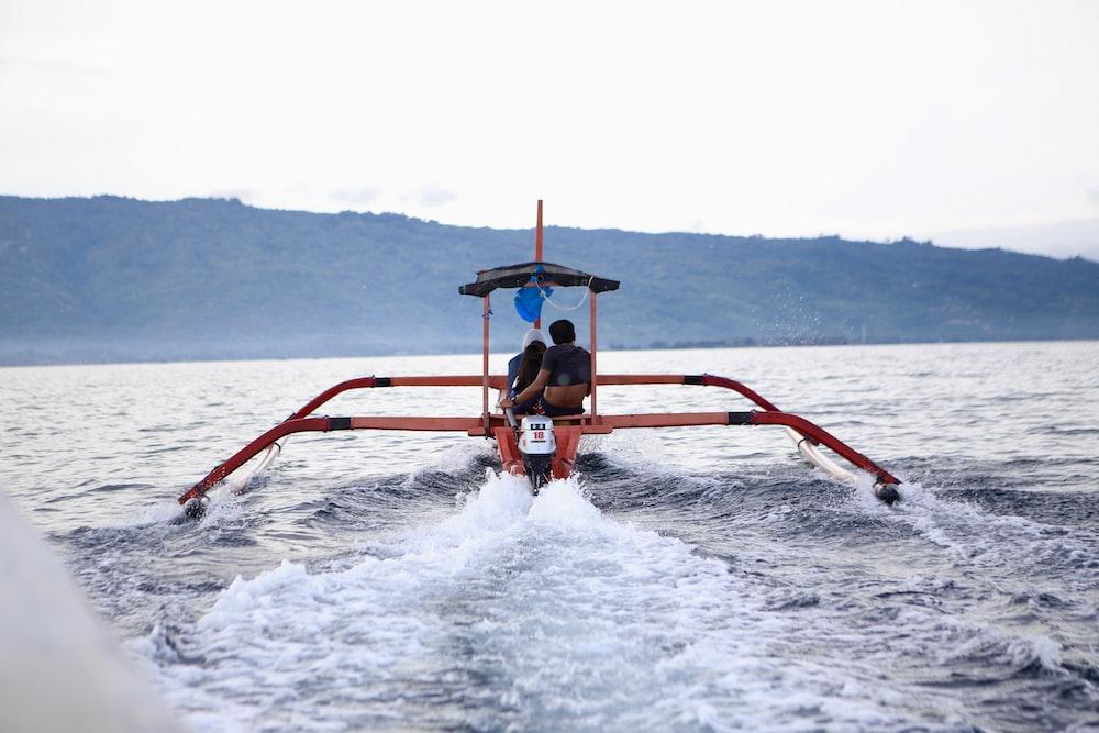 men riding boat