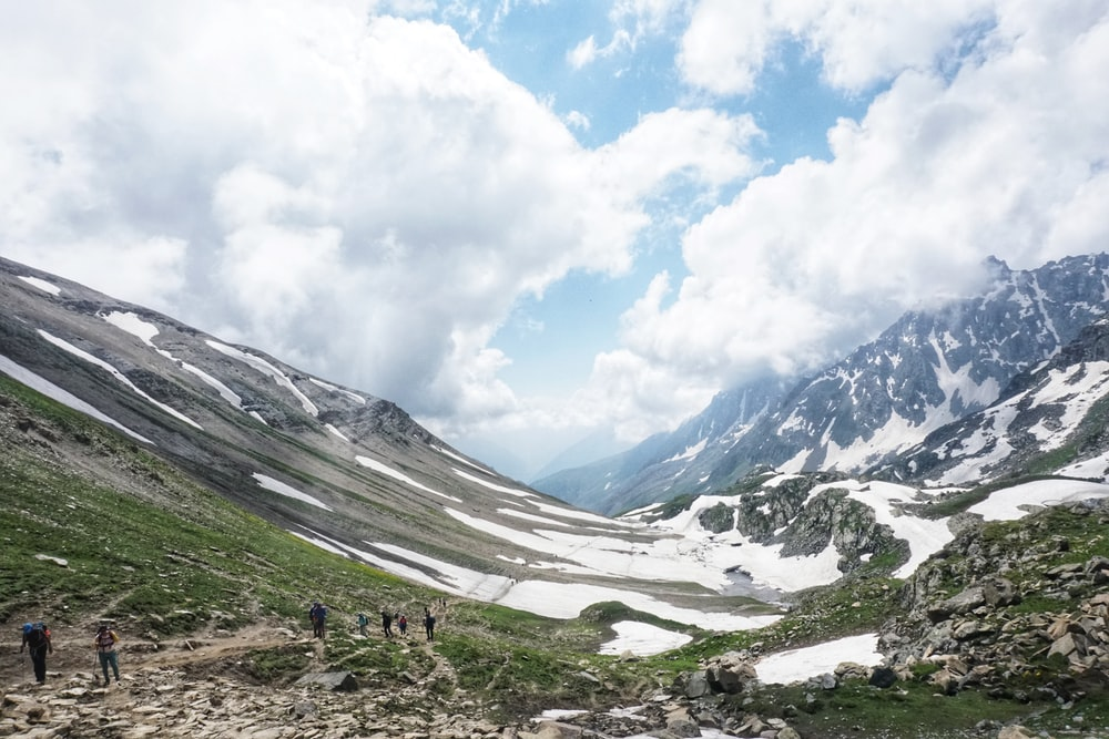 snow-capped mountain under white clouds