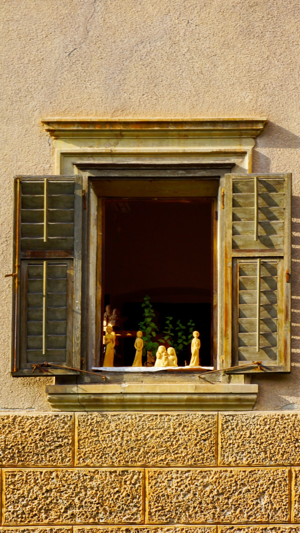 white figurine on window