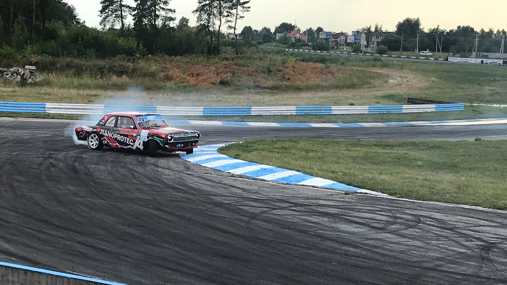 red and black racing car on track