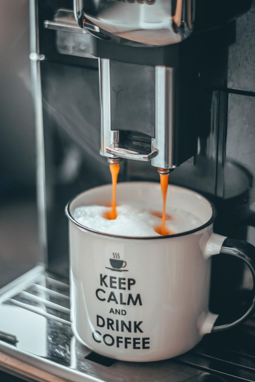 cream on white and black mug