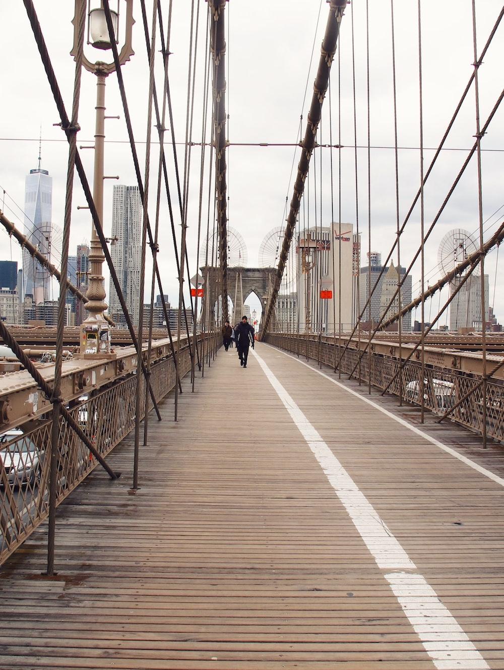 people walking on bridge during dayime