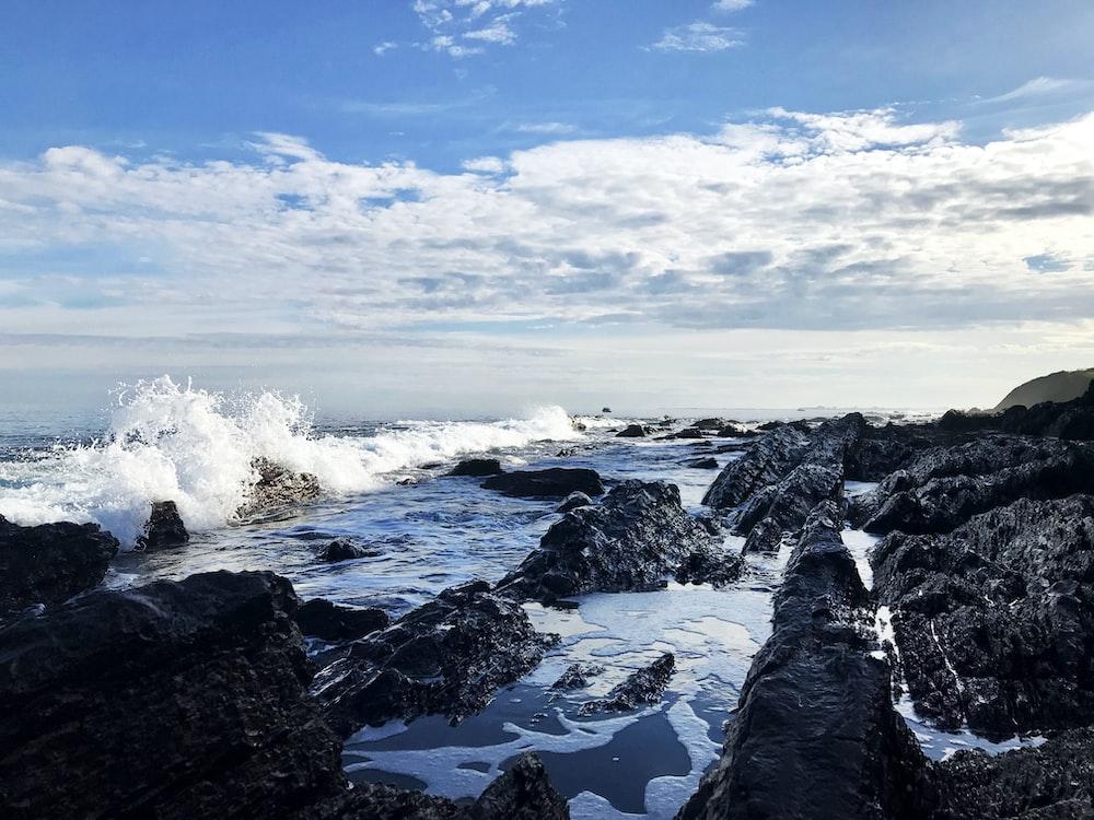 ocean waves crashing on stone