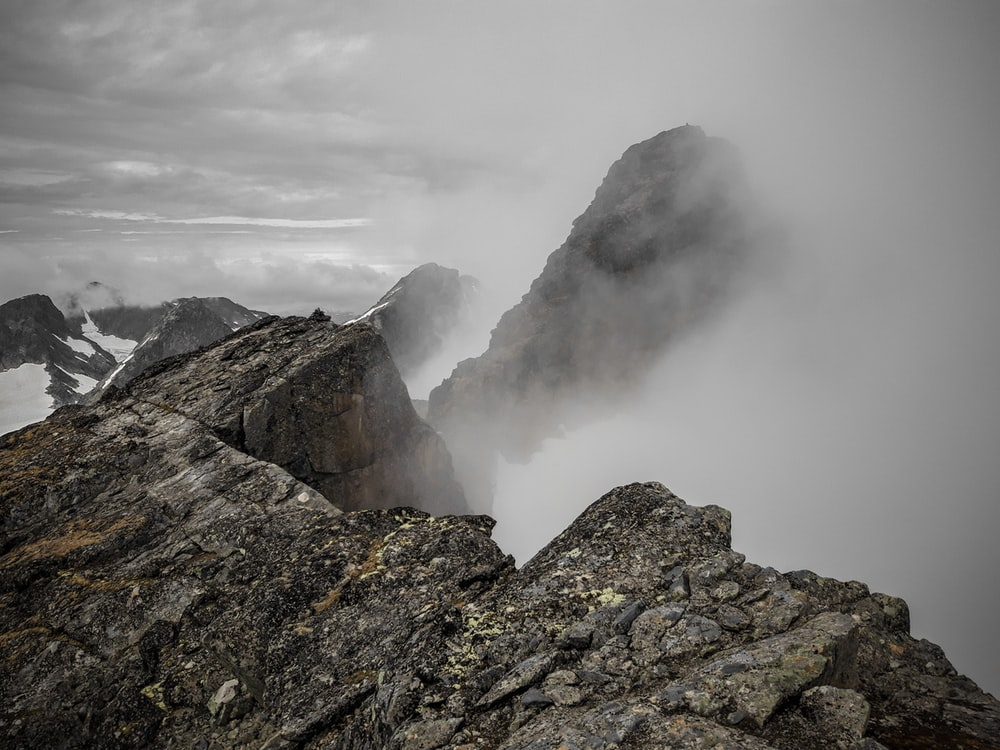 rocky mountain with fog